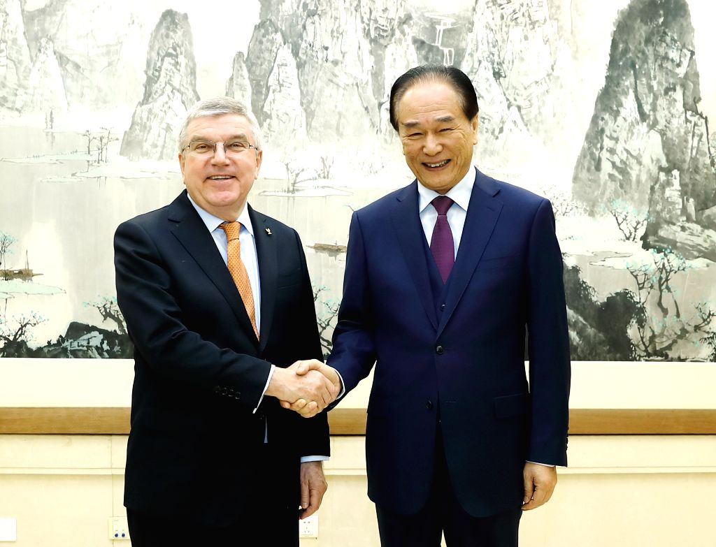 BEIJING, Jan. 30, 2019 - Cai Mingzhao, president of Xinhua News Agency, meets with Thomas Bach, president of the International Olympic Committee (IOC), in Beijing, capital of China, Jan. 30, 2019.