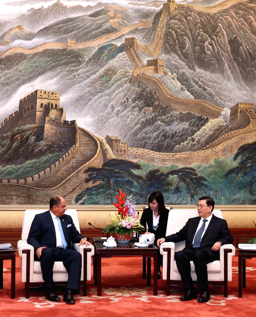 Zhang Dejiang (R), chairman of the Standing Committee of the National People's Congress (NPC), meets with Costa Rica President Luis Guillermo Solis at the Great Hall