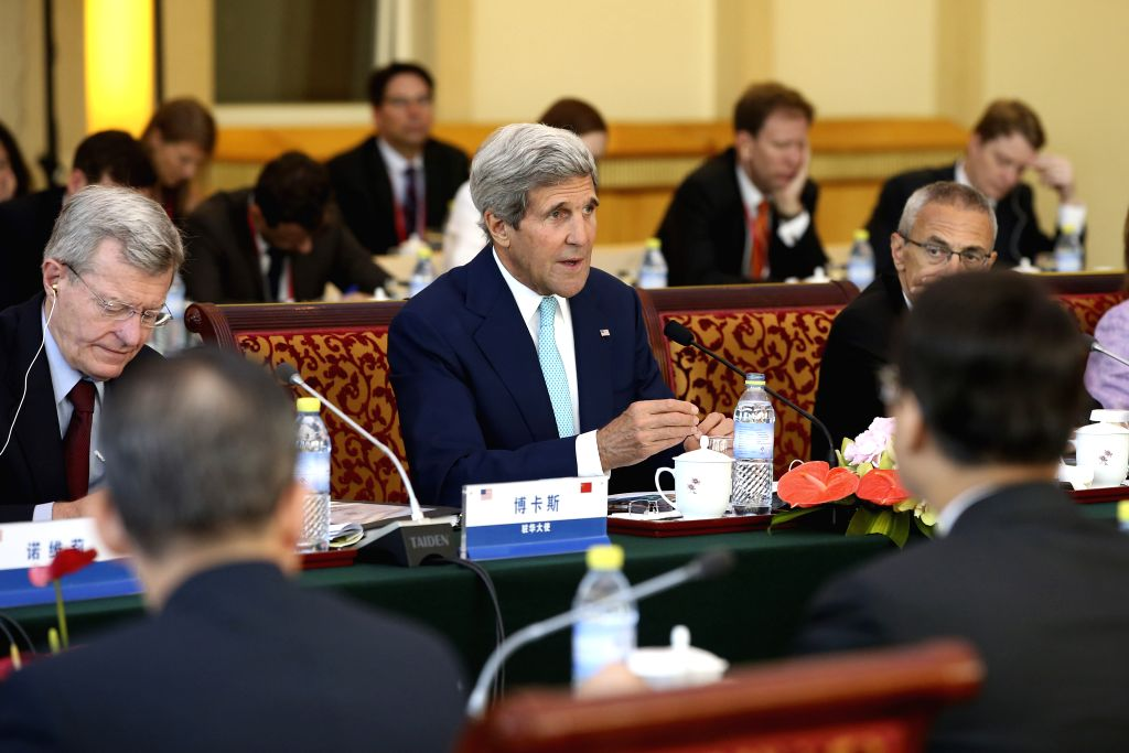 U.S. Secretary of State John Kerry (C) speaks during the strategic dialogue of the sixth round of the China-U.S. Strategic and Economic Dialogue (S&ED) in ...