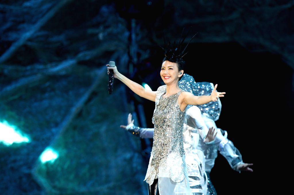"Singaporean singer Stefanie Sun performs at her ""Kepler"" world tour in Beijing, capital of China, July 12, 2014."