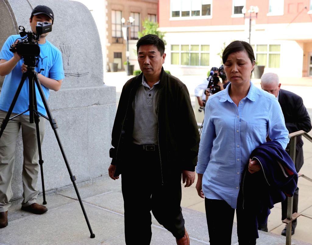 BEIJING, July 19, 2019 - Family members of Chinese scholar Zhang Yingying head to a federal courthouse building in Peoria, Illinois, the United States, July 18, 2019.