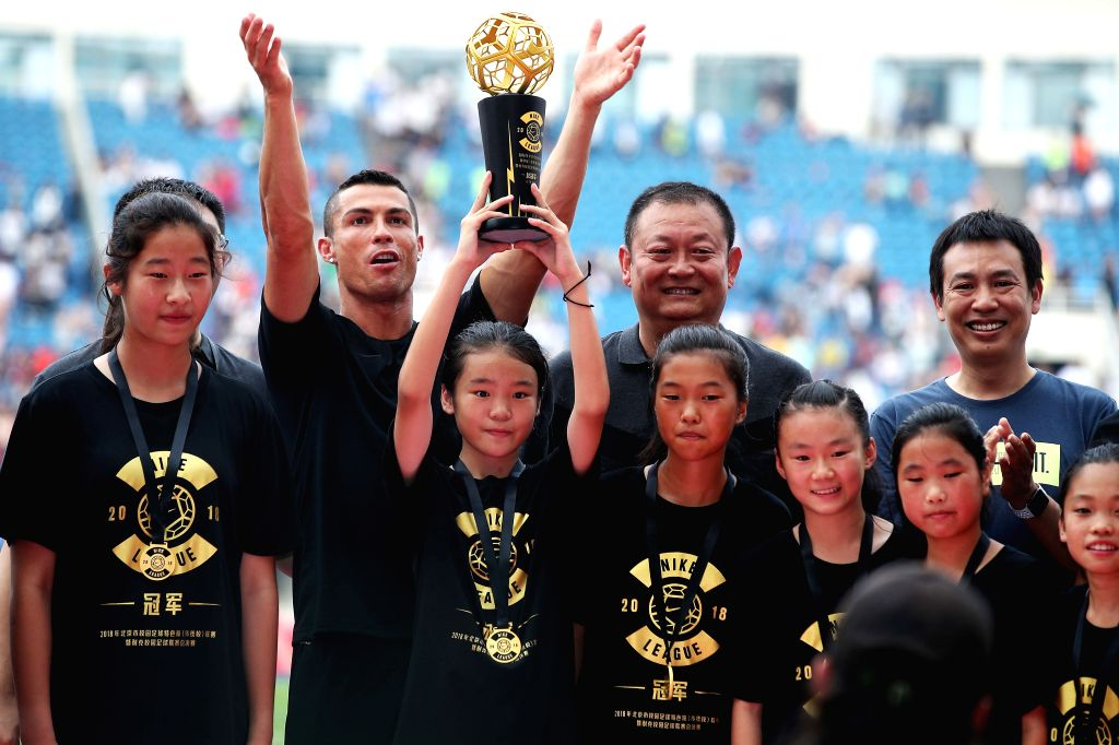 BEIJING, July 20, 2018 - Portuguese football player Cristiano Ronaldo (2nd L)  presents award to the champion players of Nike Campus Soccer League as he attends a promotional event in Beijing, China, ...