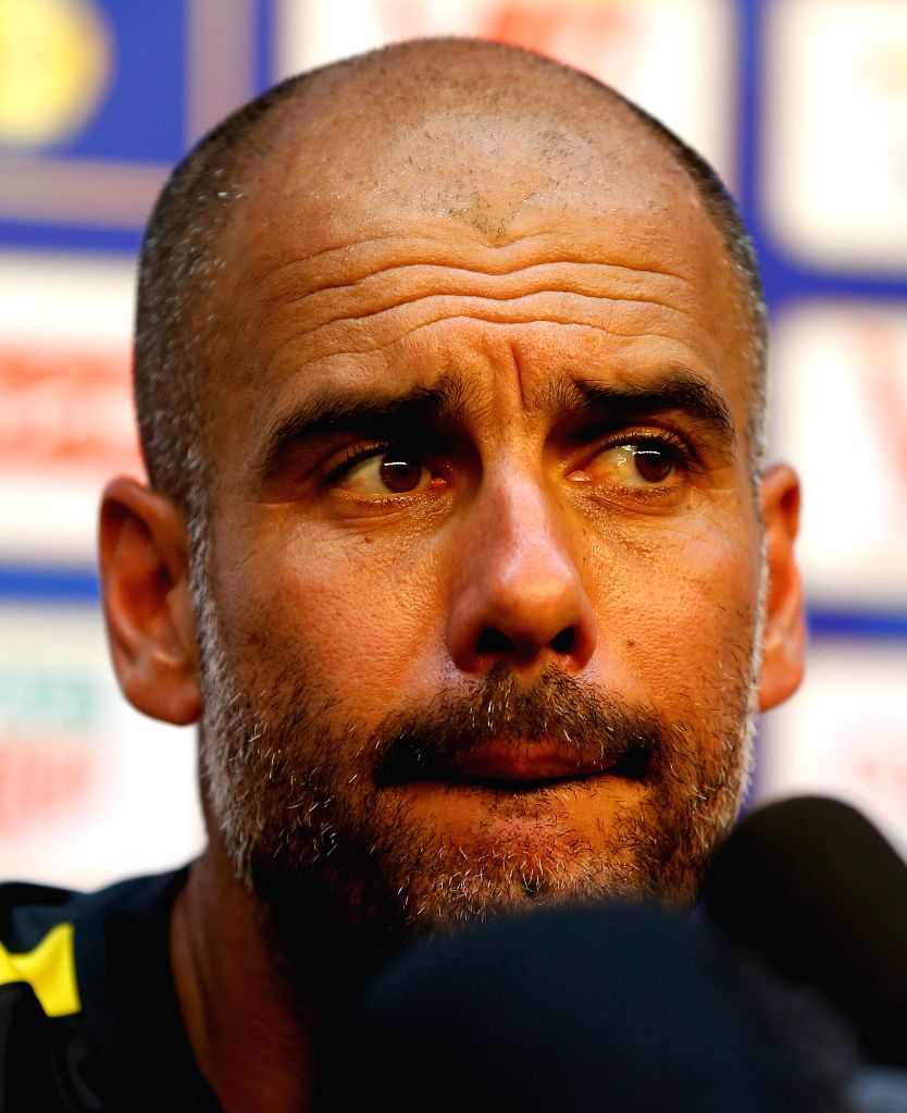 BEIJING, July 24, 2016 - Pep Guardiola, manager of Manchester City looks on during the press conference for the match against Manchester United FC of 2016 International Champions Cup China soccer ...