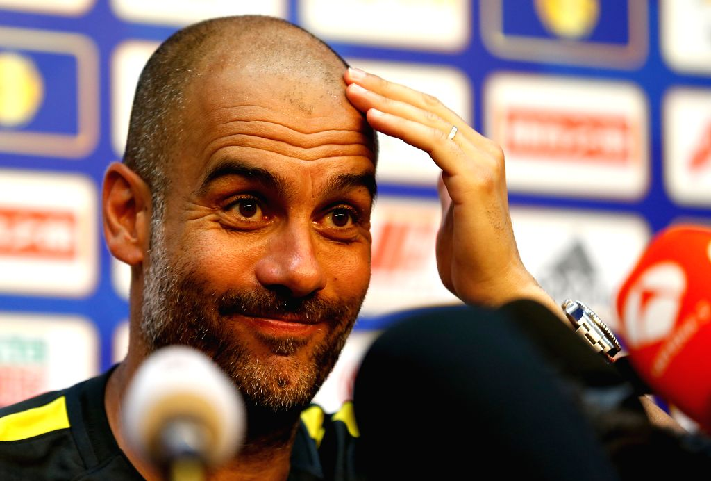 BEIJING, July 24, 2016 - Pep Guardiola, manager of Manchester City gestures during the  press conference for the match against Manchester United FC of 2016 International Champions Cup China soccer ...