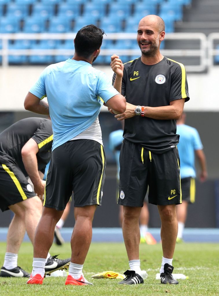 BEIJING, July 24, 2016 - Pep Guardiola (R), manager of Manchester City talks with player Sergio Aguero during the training session for the match against Manchester United FC of 2016 International ...