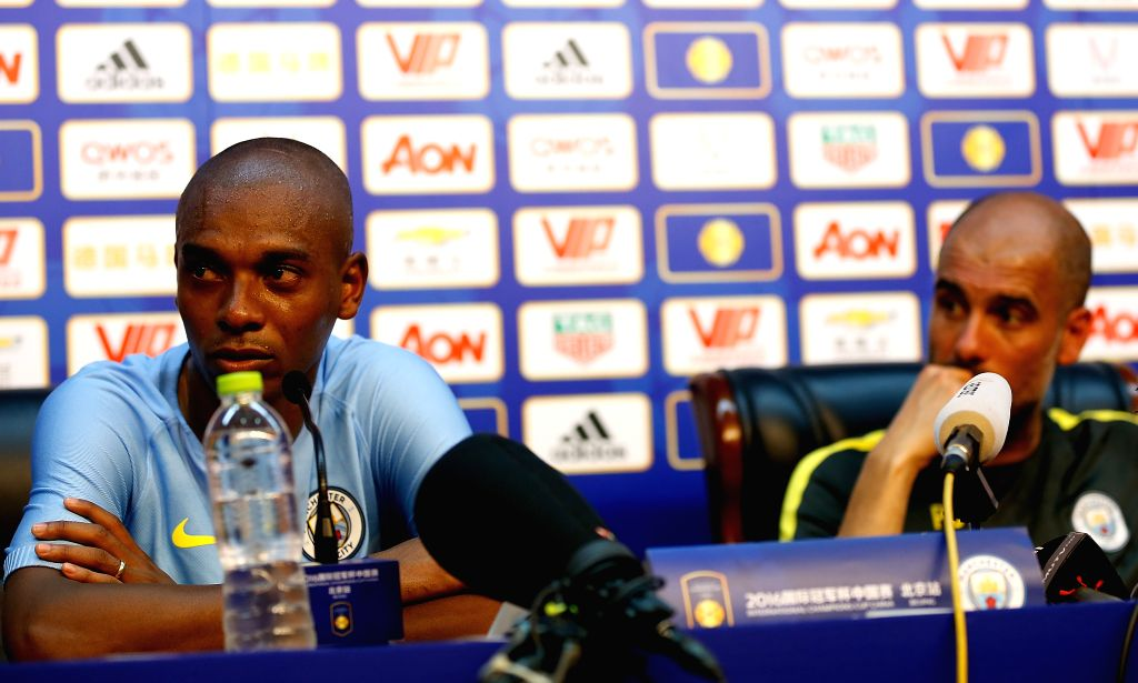 BEIJING, July 24, 2016 - Pep Guardiola (R), manager of Manchester City and player Fernando Luiz Rosa answer questions during the press conference for the match against Manchester United FC of 2016 ...
