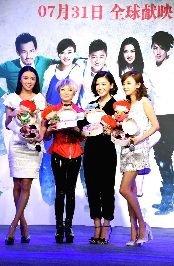 """Actresses Ivy Chen (1st R), Fiona Sit (1st L) and Yang Zishan (2nd R) attend a press conference for the public premiere of the romance comedy film """"Girls - Ivy Chen"""