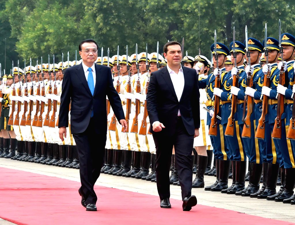 BEIJING, July 4, 2016 - Chinese Premier Li Keqiang (L, front) holds a welcoming ceremony for visiting Greek Prime Minister Alexis Tsipras (R, front) before their talks in Beijing, capital of China, ... - Alexis Tsipras