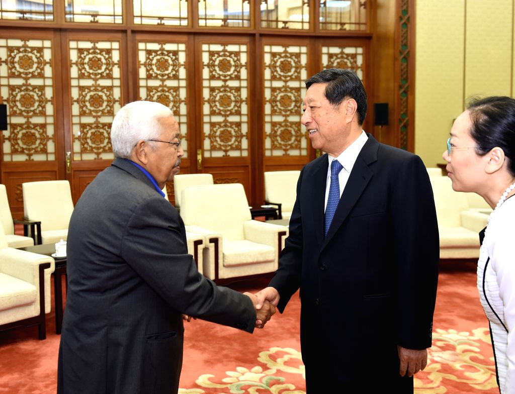 BEIJING, July 4, 2016 - Zhang Ping (C), vice chairman of the Standing Committee of China's National People's Congress, meets with former President of Cape Verde Pedro Pires (L) in Beijing, capital of ...