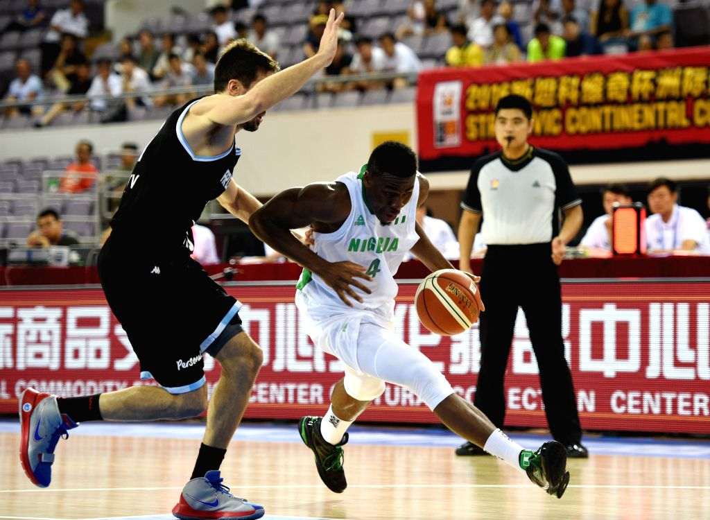 BEIJING, July 6, 2016 - Benjamin Uzoh(R) of Nigeria breaks through with the ball during a match between Argentina and Nigeria at 2016 Stankovic Continental Cup Basketball Tournament in Beijing, ...