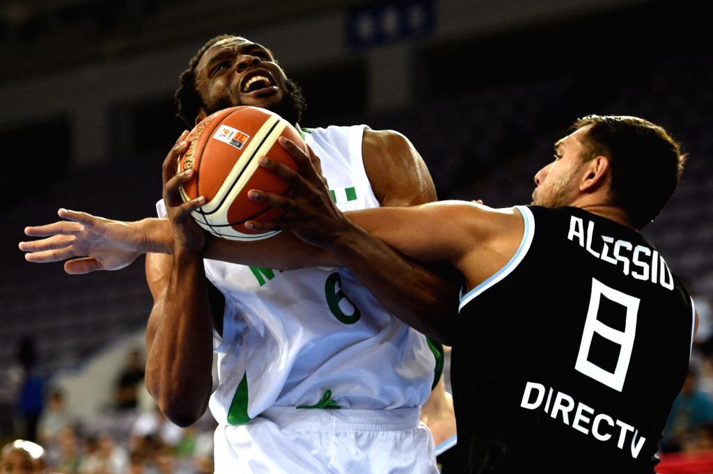 BEIJING, July 6, 2016 - Jose Alessio(R) of Argentina vies with Ikechukwu Diogu of Nigeria during a match between Argentina and Nigeria at 2016 Stankovic Continental Cup Basketball Tournament in ...