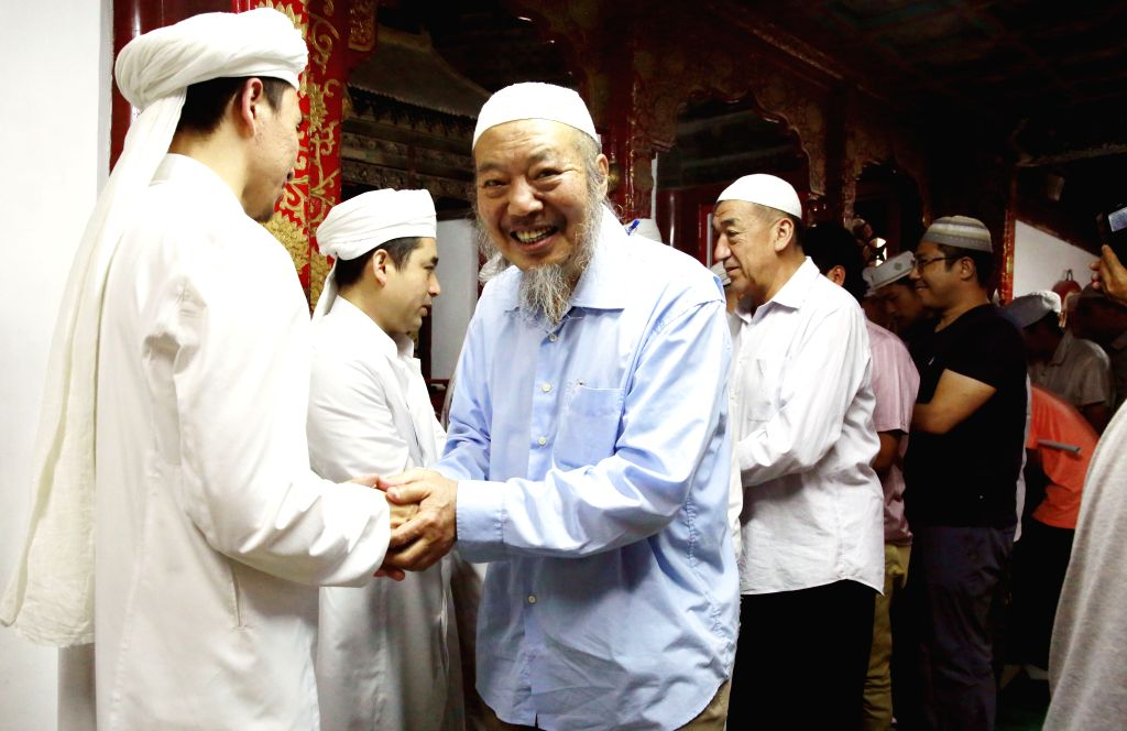 BEIJING, July 6, 2016 - People greet each other during a prayer session on Eid al-Fitr at the Niujie Mosque in Beijing, capital of China, July 6, 2016. Muslims across China began to celebrate the Eid ...