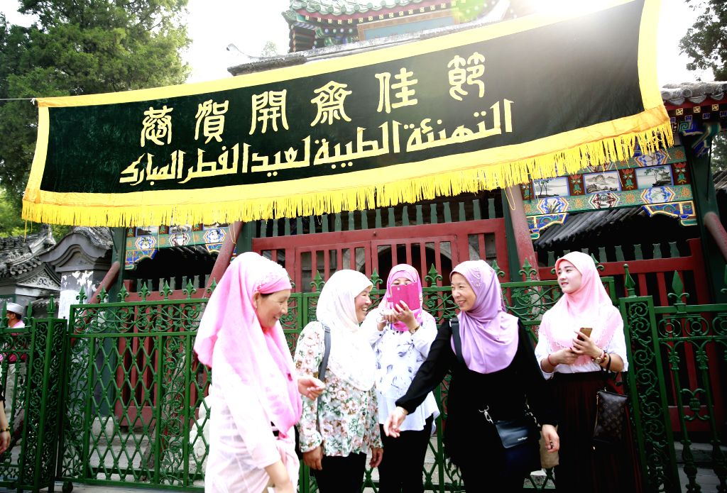 BEIJING, July 6, 2016 - Women walk to attend a prayer session on Eid al-Fitr at the Niujie Mosque in Beijing, capital of China, July 6, 2016. Muslims across China began to celebrate the Eid al-Fitr, ...