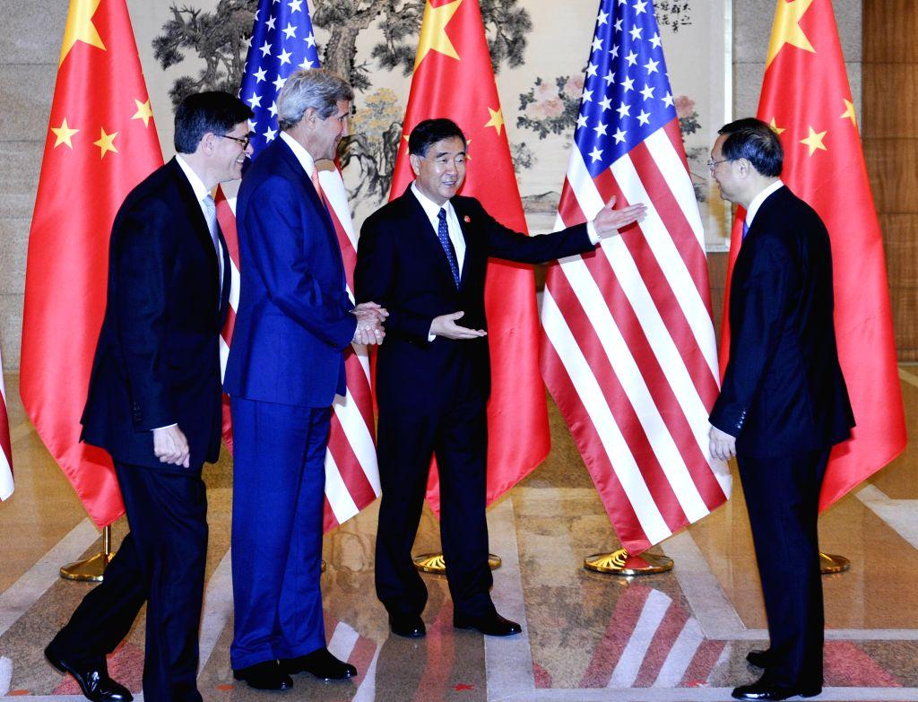 Chinese Vice Premier Wang Yang (2nd R), State Councilor Yang Jiechi (1st R), U.S. Secretary of State John Kerry (2nd L) and Treasury Secretary Jacob Lew pose for ...