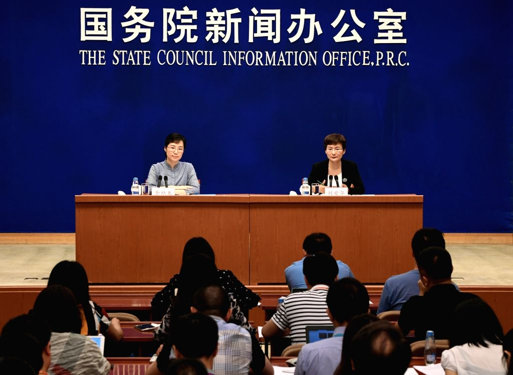 BEIJING, June 14, 2017 - Liu Aihua (R), spokeswoman of the National Bureau of Statistics (NBS), attends a press conference in Beijing, capital of China, June 14, 2017.  China's economic growth held ...