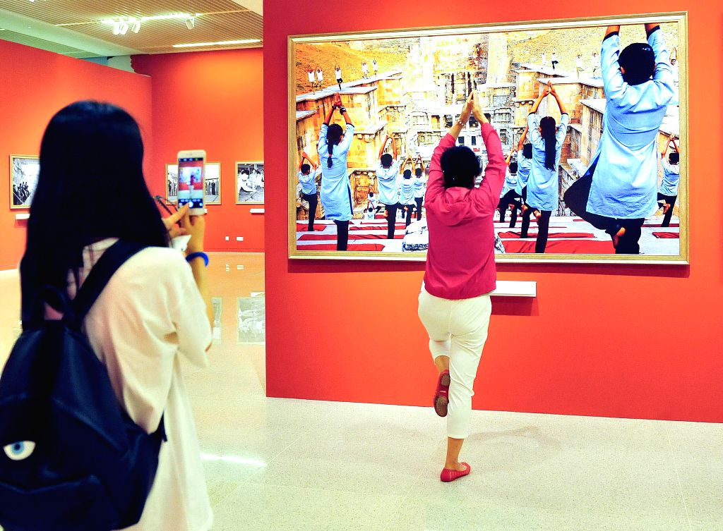 BEIJING, June 15, 2017 - Visitors watch the creations at the BRICS Media Joint Photography Exhibition at the National Museum of China in Beijing, capital of China, June 15, 2017. The exhibition, ...