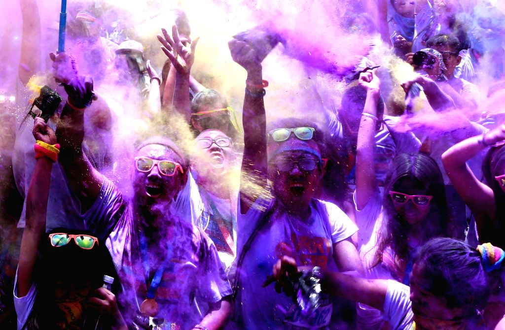 Runners take part in the 5km Color Run in Beijing, capital of China, June 20, 2015. Some 30,000 runners finished this year's Color Run event here Saturday.  ...