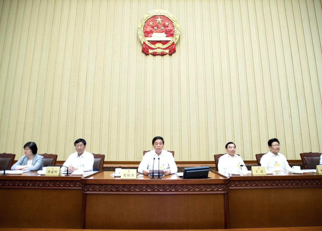 BEIJING, June 22, 2018 - Li Zhanshu (C), chairman of the National People's Congress (NPC) Standing Committee, presides over the closing meeting of a bimonthly session of the 13th NPC Standing ...