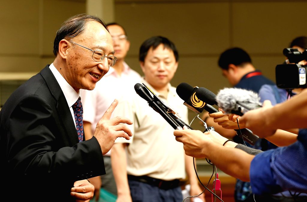 """BEIJING, June 23, 2016 - Liu Peng (L), Director of General Administration of Sports of China, answers questions after a press conference on Implementation of the """"National Fitness Program ..."""
