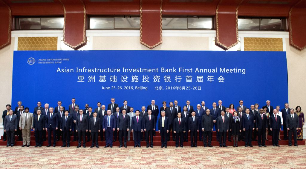 BEIJING, June 25, 2016 - Chinese Vice Premier Zhang Gaoli (C, front) poses for a group photo with participants of the first Annual Meeting of the Board of Governors of the Asian Infrastructure ...
