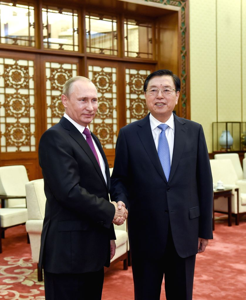 BEIJING, June 25, 2016 - Zhang Dejiang (R), chairman of the Standing Committee of China's National People's Congress, meets with Russian President Vladimir Putin in Beijing, capital of China, June ...