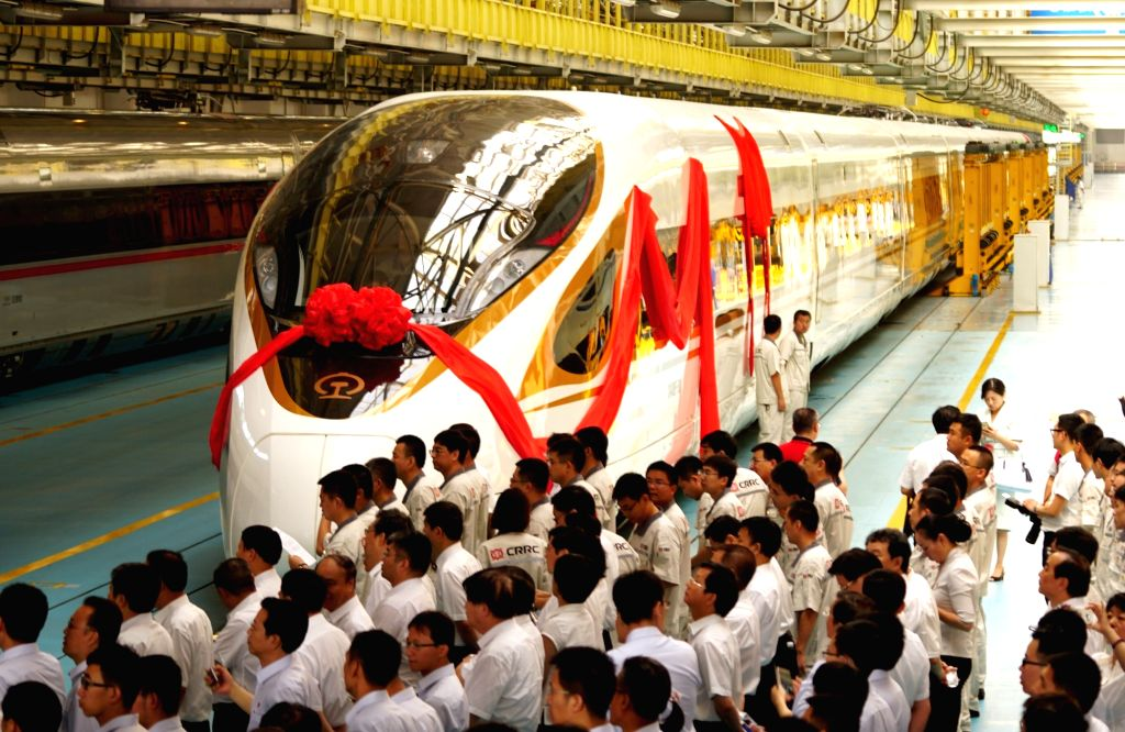 """BEIJING, June 25, 2017 - People attend a naming ceremony for the new models of China's electric multiple unit (EMU) train """"Fuxing"""" in Beijing, capital of China, June 25, 2017. China holds ..."""