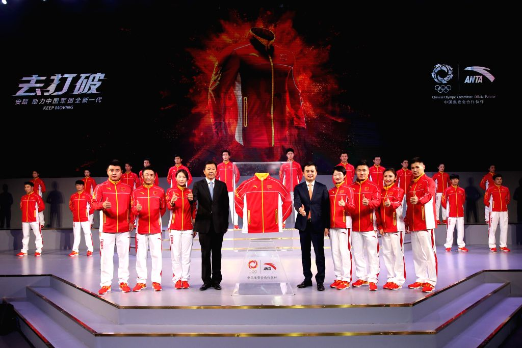 BEIJING, June 29, 2016 - Chinese Olympic champions and guests pose for photos during the ceremony to unveil the Chinese Olympic team's uniforms for the Rio 2016 Olympic Games, in Beijing, capital of ...