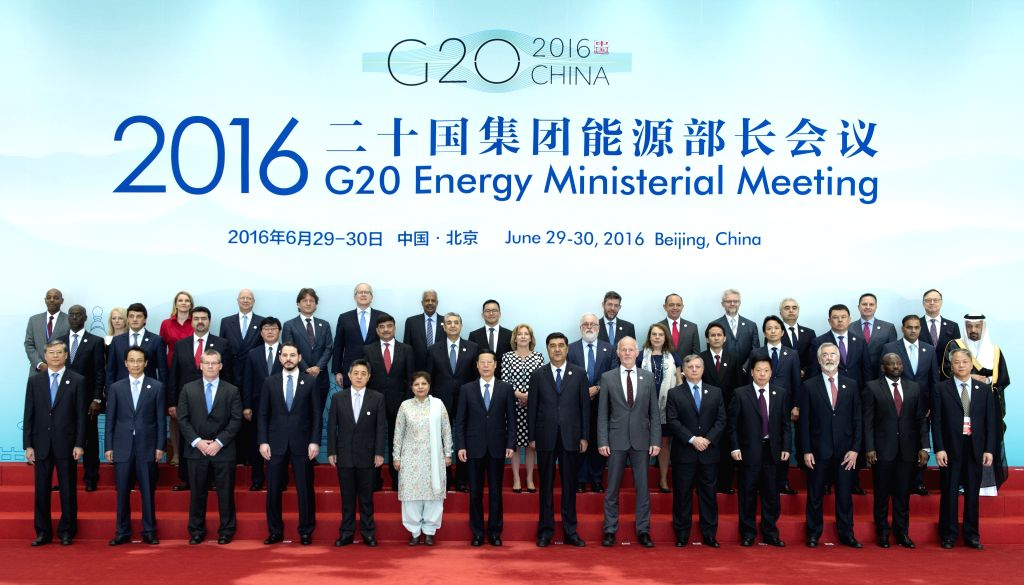 BEIJING, June 29, 2016 - Chinese Vice Premier Zhang Gaoli (7th L, front) poses for a group photo with participants of the G20 Energy Ministerial Meeting in Beijing, capital of China, June 29, 2016. ...
