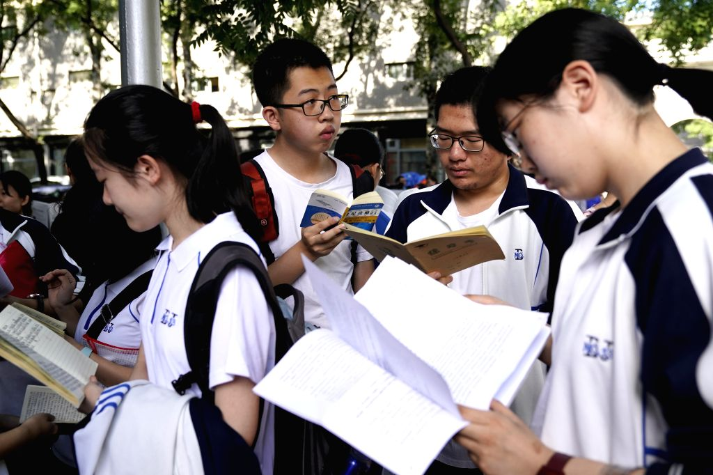 BEIJING, June 7, 2018 - Examinees review before the exam at the Beijing No. 4 Middle School in Beijing, capital of China, June 7, 2018. About 9.75 million students have registered for the national ...