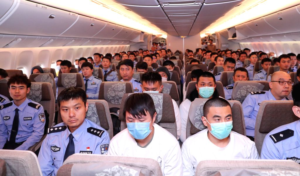 BEIJING, June 7, 2019 - The police escort suspects on a plane for Beijing on June 7, 2019. A group of 94 suspects, escorted by Chinese police, were flown to Beijing from Spain Friday morning, the ...