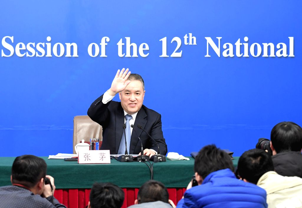 BEIJING, March 10, 2017 - Zhang Mao, head of the State Administration for Industry and Commerce, greets journalists at a press conference on deepening reforms to commerce affairs administration for ...