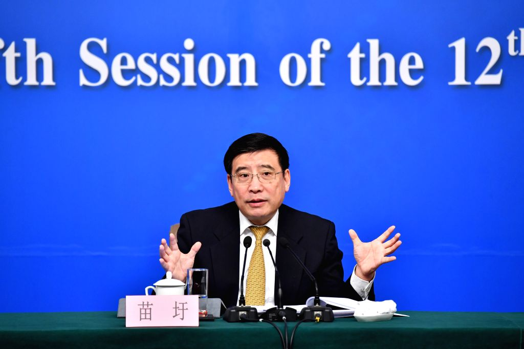 "BEIJING, March 11,2017 - Miao Wei, Minister of Industry and Information Technology, answers questions at a press conference on ""Made in China 2025"" plan for the fifth session of the 12th ..."