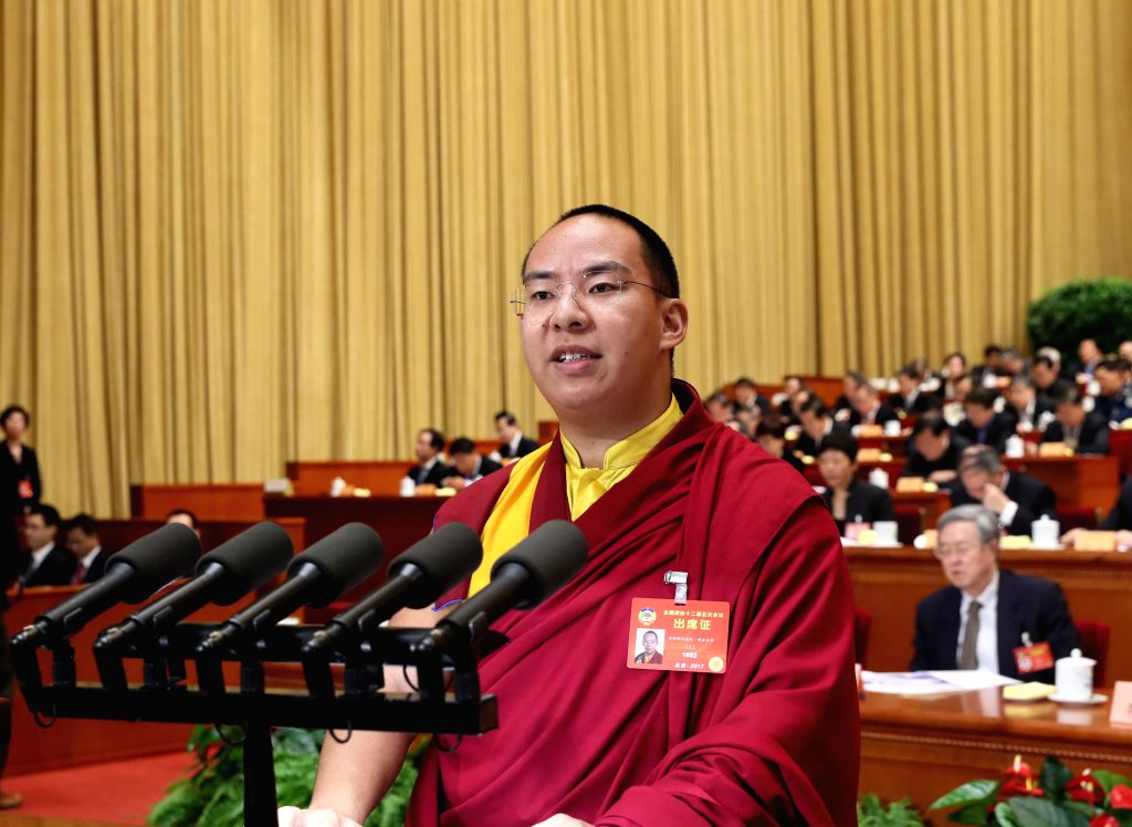 BEIJING, March 11, 2017 - The 11th Panchen Lama Bainqen Erdini Qoigyijabu, a member of the 12th National Committee of the Chinese People's Political Consultative Conference (CPPCC), delivers a speech ...