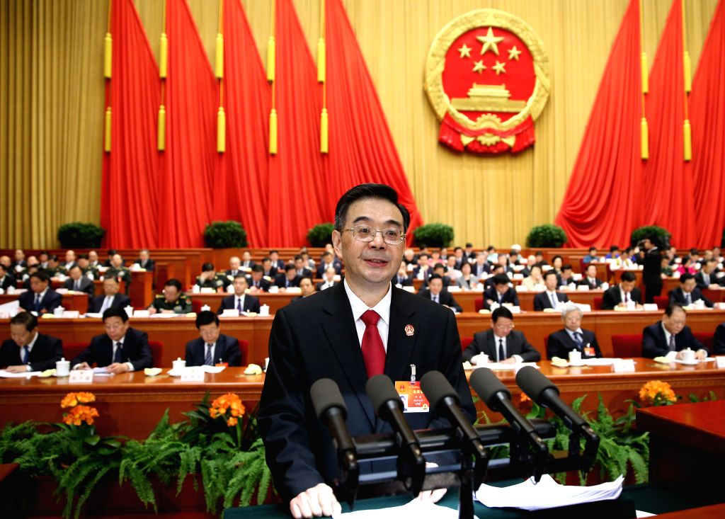 Zhou Qiang, president of China's Supreme People's Court (SPC), delivers a report on the SPC's work at the third plenary meeting of the third session of the 12th ...