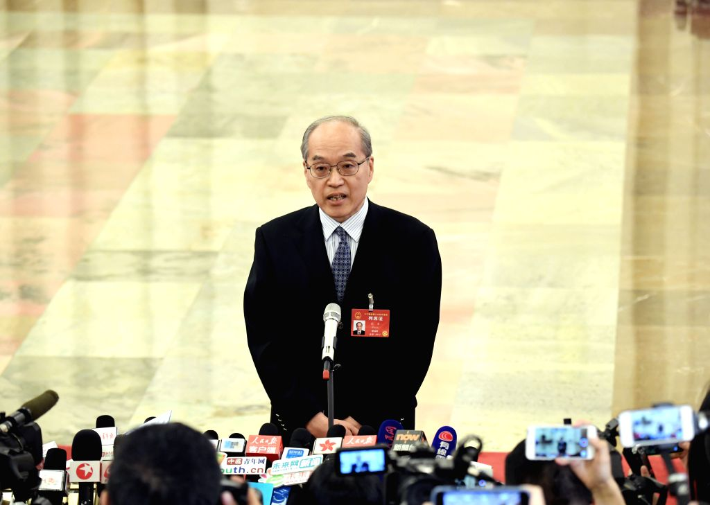 BEIJING, March 12, 2017 - Chinese Minister of Justice Zhang Jun receives an interview before the third plenary meeting of the fifth session of the 12th National People's Congress at the Great Hall of ...