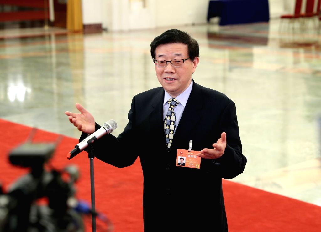 BEIJING, March 12, 2017 - Li Wei, director of the Development Research Center of the State Council, receives an interview after the third plenary meeting of the fifth session of the 12th National ...