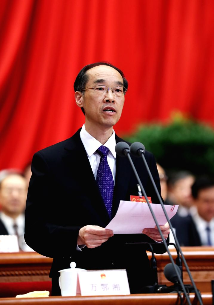 BEIJING, March 12, 2017 - Wan Exiang presides over the third plenary meeting of the fifth session of the 12th National People's Congress at the Great Hall of the People in Beijing, capital of China, ...