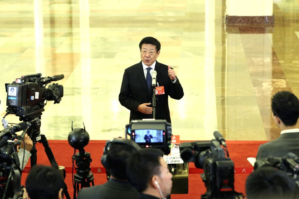 BEIJING, March 12, 2019 - Zhang Jianlong, director of the National Forestry and Grassland Administration, receives an interview before the third plenary meeting of the second session of the 13th ...