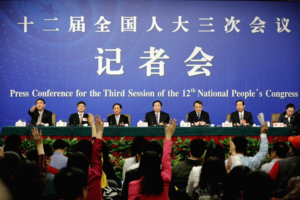 Xie Heping(C), Shen Jian(3rd R), Luo Weiqi(3rd L), Li Jianbao(2nd R), Zheng Qiang(2nd L),  five deputies to the 12th National People's Congress (NPC), give a press ...
