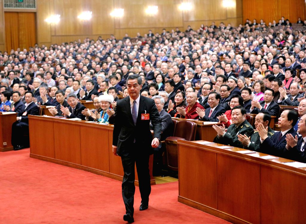 BEIJING, March 13, 2017 - Leung Chun-ying walks to the rostrum after being elected vice chairman of the 12th National Committee of the Chinese People's Political Consultative Conference (CPPCC) at ...