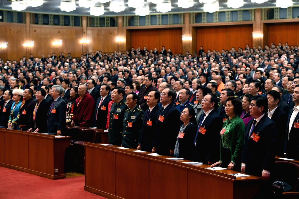BEIJING, March 13, 2017 - Members of the 12th National Committee of the Chinese People's Political Consultative Conference (CPPCC) sing the national anthem during the closing meeting of the fifth ...
