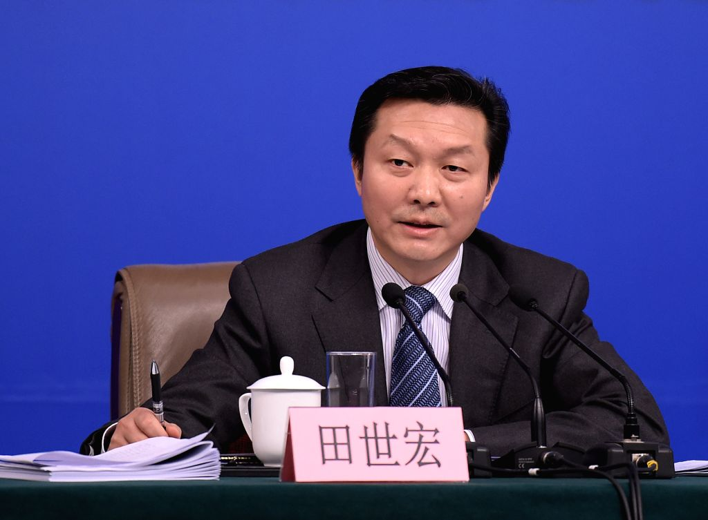 BEIJING, March 14, 2017 - Tian Shihong, head of the Standardization Administration of China, answers questions at a press conference on quality improvement for the fifth session of the 12th National ...