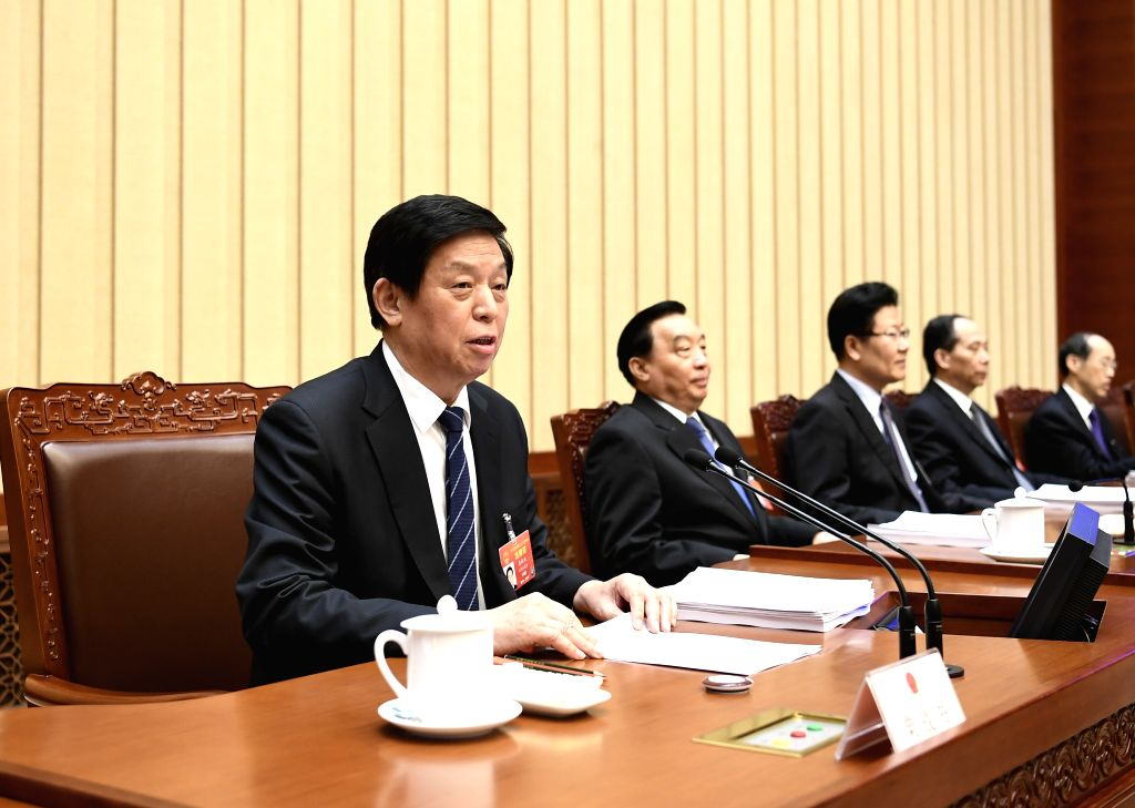 BEIJING, March 14, 2019 - Li Zhanshu, executive chairman of the presidium of the second session of the 13th National People's Congress (NPC), presides over the third meeting of the presidium at the ...