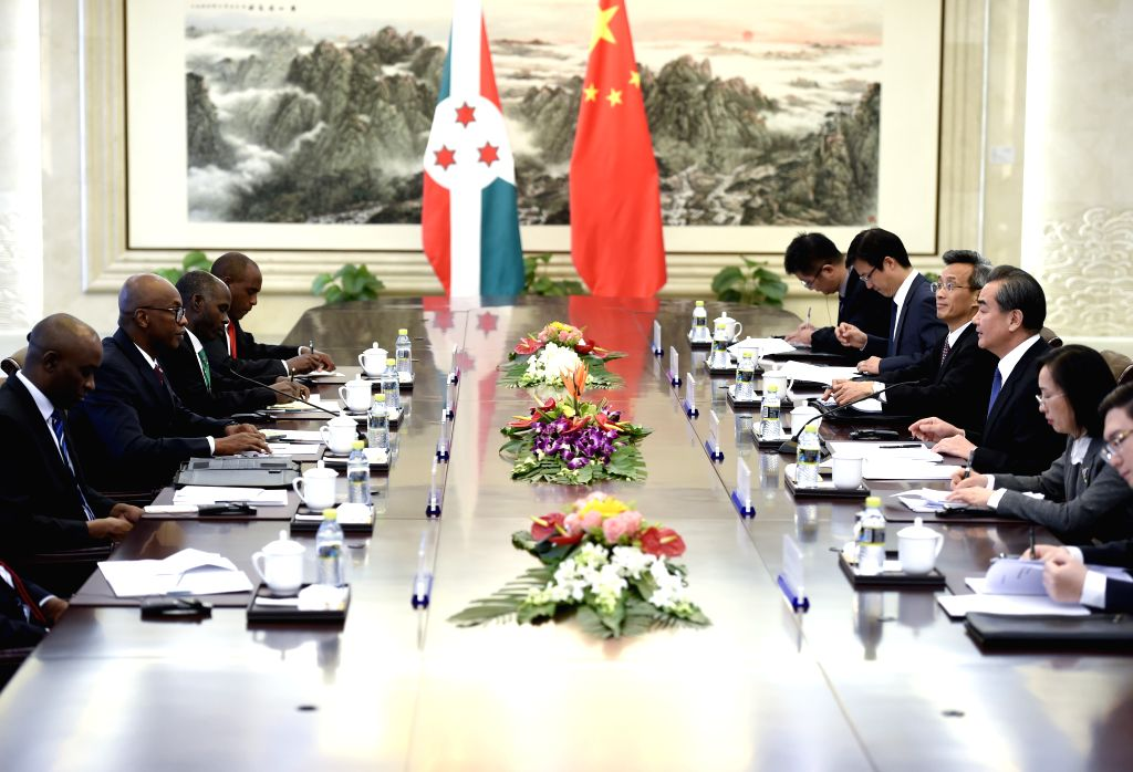 BEIJING, March 15, 2017 - Chinese Foreign Minister Wang Yi holds talks with Burundian Minister of External Relations and International Cooperation Alain Aime Nyamitwe, in Beijing, capital of China, ... - Wang Y