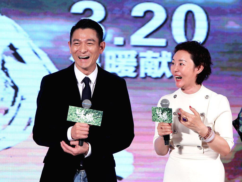 "Actor Andy Lau (L) and director Peng Sanyuan attend a premiere ceremony of the film ""Lost and Love"" in Beijing, capital of China, March 16, 2015. The ... - Andy Lau"