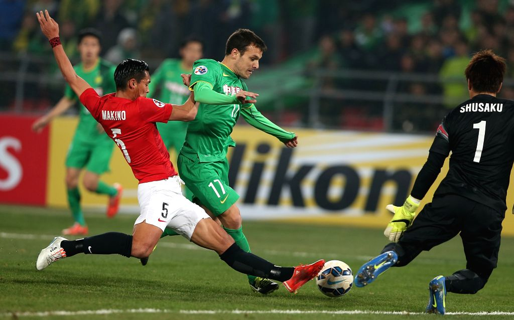 Batalla (C) of China's Beijing Guoan shoots the ball during a Group G match against Japan's Urawa Red Diamonds at the AFC Champions League 2015 in Beijing, capital ...