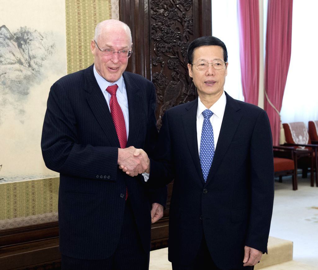 Chinese Vice Premier Zhang Gaoli (R), also a member of the Standing Committee of the Political Bureau of the Communist Party of China (CPC) Central Committee, ...