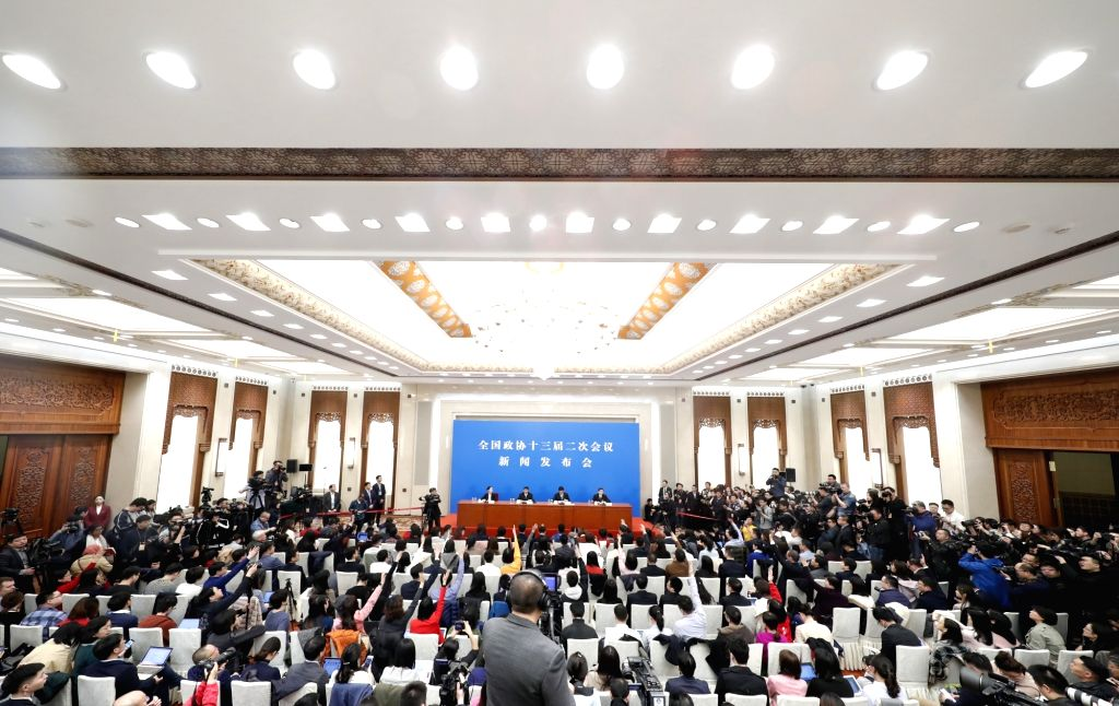 BEIJING, March 2, 2019 - Guo Weimin, spokesman of the second session of the 13th National Committee of the Chinese People's Political Consultative Conference (CPPCC), attends a press conference at ...