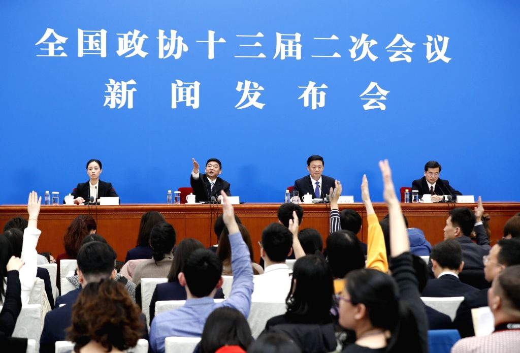 BEIJING, March 2, 2019 - Journalists raise hands to ask questions at the press conference of the second session of the 13th National Committee of the Chinese People's Political Consultative ...