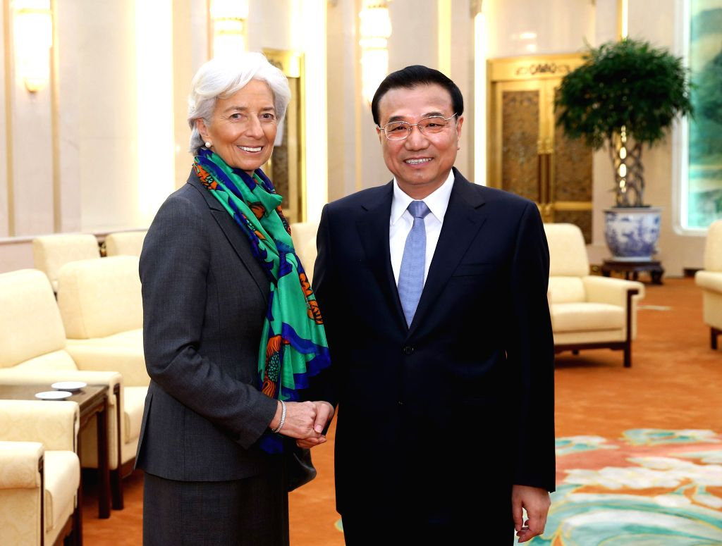 Chinese Premier Li Keqiang (R) meets with Christine Lagarde, managing director of the International Monetary Fund (IMF), in Beijing, capital of China, March 23, ...